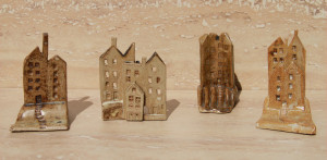 Group of Slab Minis (small constructions) - buildings, some on small hills or mounds
